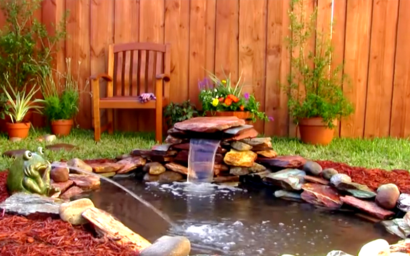 How to add a small waterfall to your pond for Build a pond in your backyard