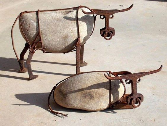 Cattle made from river rock, railroad spikes, railroad track, steel wire, and nuts