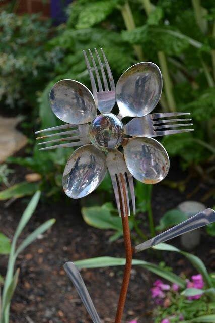 Garden art created from old kitchen utensils