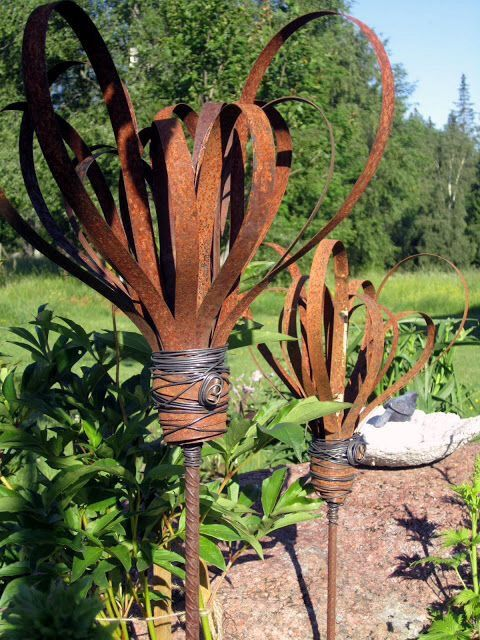 Rusty bands made into garden art